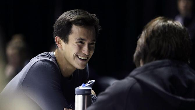 Patrick Chan of Canada talks during a practice session for the World Figure Skating Championships Monday, March 11, 2013, in London, Ontario. (AP Photo/Darron Cummings)