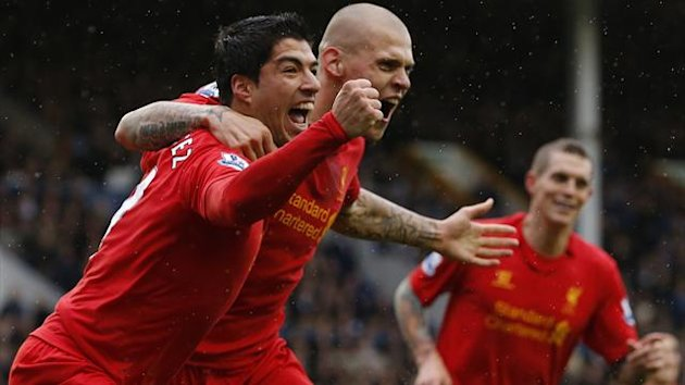 Liverpool's Luis Suarez (L) celebrates with Martin Skrtel after scoring a goal during their English Premier League match against Everton at Goodison Park