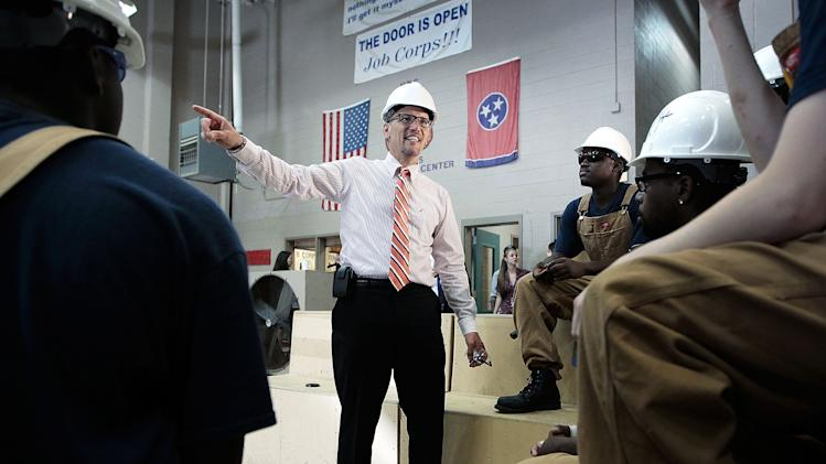 U.S. Labor Secretary Thomas Perez talks with carpentry students during a trip to the Benjamin L. Hooks Job Corps Center in Memphis, Tenn., Wednesday, Aug. 20, 2014. Perez toured the facility meeting students before speaking with faculty to celebrate the center's fifth anniversary. (AP Photo/The Commercial Appeal, Jim Weber)