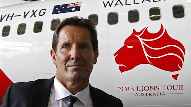 Australia coach Robbie Deans walks past a Qantas Boeing 737 plane with the official logo of the 2013 British and Irish Lions rugby team tour painted on its side at Sydney airport (Reuters)