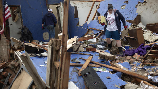 Residents salvage their belongings after their house was left devastated by a tornado in Moore, Oklahoma