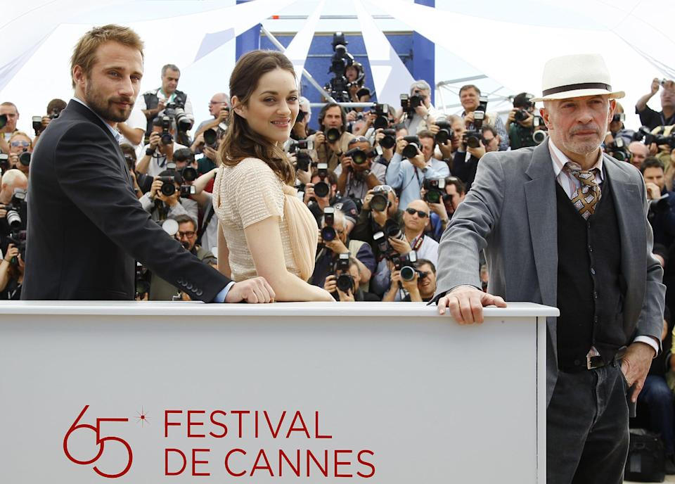 From left, actors Matthias Schoenaerts, Marion Cotillard and director Jacques Audiard pose during a photo call for Rust and Bone at the 65th international film festival, in Cannes, southern France, Thursday, May 17, 2012. (AP Photo/Francois Mori)