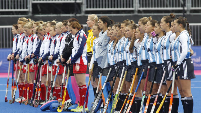Britain's players, left, and Argentina's players stand for a national anthem before the start of the women's gold medal field hockey match between Britain and Argentina at the Riverbank field hockey arena in the Olympic Park in London, Sunday, May 6, 2012. (AP Photo/Sang Tan)