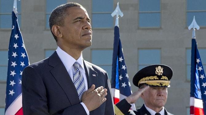 President Barack Obama and Joint Chiefs Chairman Gen. Martin Dempsey participate in a ceremony at the Pentagon Memorial,Tuesday, Sept. 11, 2012, to mark the 11th anniversary of the 9/11 attacks. (AP Photo/Carolyn Kaster)
