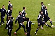 Dinamo Zagreb's players take part in a training session on November 5 at the Parc des Princes stadium in Paris, on the eve of the UEFA Champions League Group A football match against PSG. Three Croatian supporters of Dinamo Zagreb, who were arrested in the French capital after clashes with Paris Saint-Germain fans, were sentenced on Thursday by a French court to four months in prison