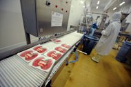 A picture taken on June 23, 2011 in Castelnaudary, southeastern France, shows a French food industry employee working on the production chain of beef steaks. President Traian Basescu said Sunday he feared lasting damage to Romania's reputation if a Romanian meat supplier is found to be at fault over Europe's spiralling horsemeat scandal