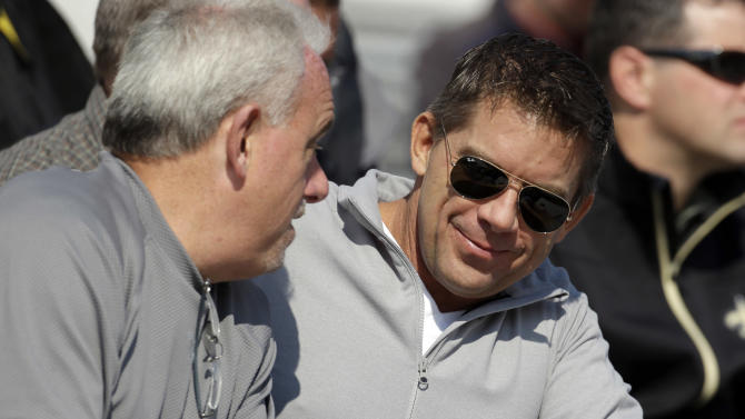 New Orleans Saints coach Sean Payton talks with assistant head coach Joe Vitt, left, during Senior Bowl football practice at Ladd-Peebles Stadium in Mobile, Ala., Wednesday, Jan. 23, 2013. The NFL reinstated Payton on Tuesday following a season long suspension. Vitt served has head coach during the suspension. (AP Photo/Dave Martin)