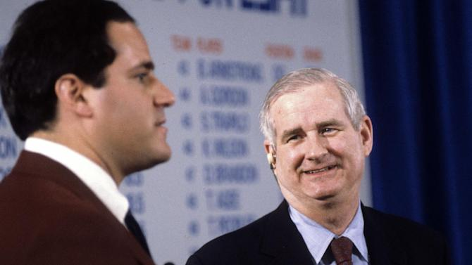 "In this undated photo provided by ESPN, host Chris Berman, left, and and college football commentator Carroll ""Beano"" Cook are shown discussing the NFL Draft. Cook died in his sleep Thursday, Oct. 10, 2012, the University of Pittsburgh announced. The 81 year-old commentator had worked for the sports network since 1986 and was the sports information director at his alma mater, the University of Pittsburgh, from 1956 to 1966. (AP Photo/ESPN, Rick LaBranche)"