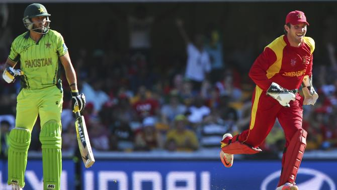 Zimbabwe wicket keeper Brendan Taylor , right,, celebrates the wicket of Pakistan's Shahid Afridi during the Pool B Cricket World Cup match in Brisbane, Australia, Sunday, March 1, 2015. (AP Photo/Tertius Pickard)