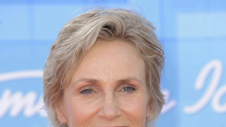 "FILE - In a May 23, 2012 file photo, Jane Lynch arrives at the ""American Idol"" finale in Los Angeles. Lynch is joining Billie Jean King and Laura Ricketts in the formation of LPAC, a lesbian Super PAC that is scheduled to be launched on Wednesday. (Photo by Jordan Strauss/Invision/AP, File)"