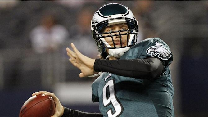 Philadelphia Eagles quarterback Nick Foles (9) warms up before an NFL football game against the Dallas Cowboys, Sunday, Dec. 2, 2012, in Arlington, Texas. (AP Photo/Tony Gutierrez)