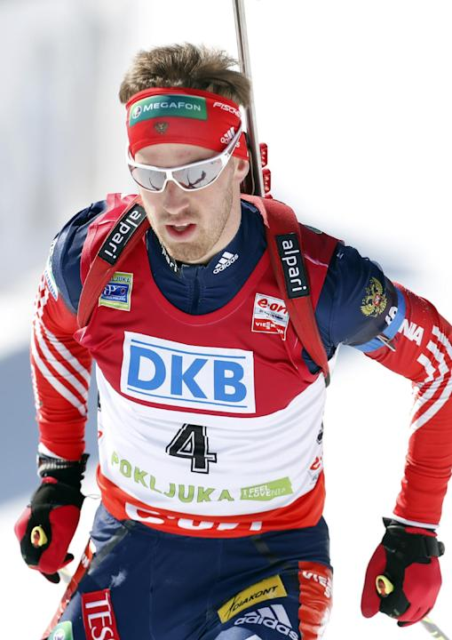 Russia's Dmitry Malyshko competes in the men's 12.5km pursuit at the biathlon World Cup competition in Pokljuka, Slovenia, Saturday, March 8, 2014