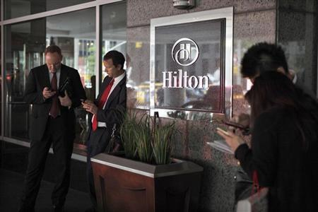 Guests wait outside at the Hilton, New York's largest Hotel, on Sixth Avenue