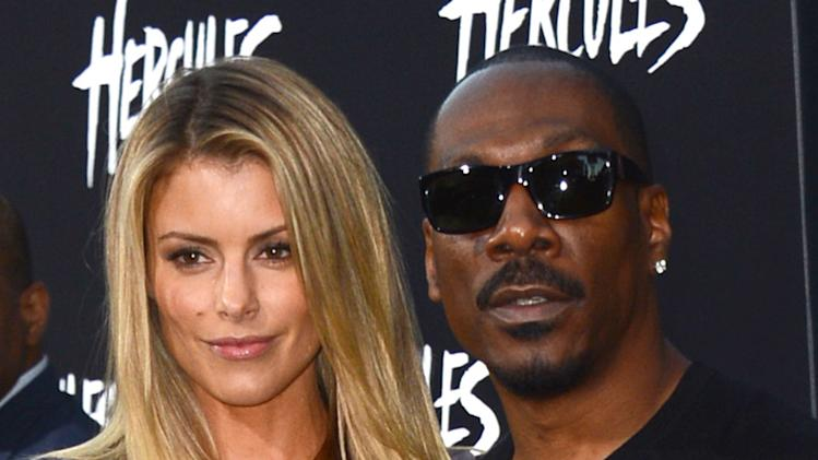 "Paige Butcher, left, and Eddie Murphy arrive at the premiere of ""Hercules"" at TCL Chinese Theatre on Wednesday, July 23, 2014, in Los Angeles. (Photo by Jordan Strauss/Invision/AP)"