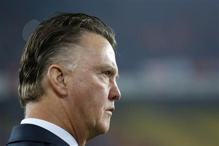 Netherlands' coach Van Gaal looks at his players before 2014 World Cup qualifying soccer match against Turkey in Istandbul