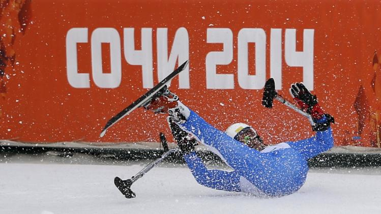 Italy's Christian Lanthaler crashes after the finish line during the men's Downhill Standing at the 2014 Sochi Paralympic Winter Games at the Rosa Khutor Alpine Center