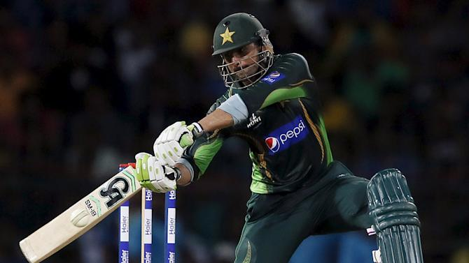 Pakistan's Malik hits boundary during their first Twenty 20 cricket match against Sri Lanka in Colombo