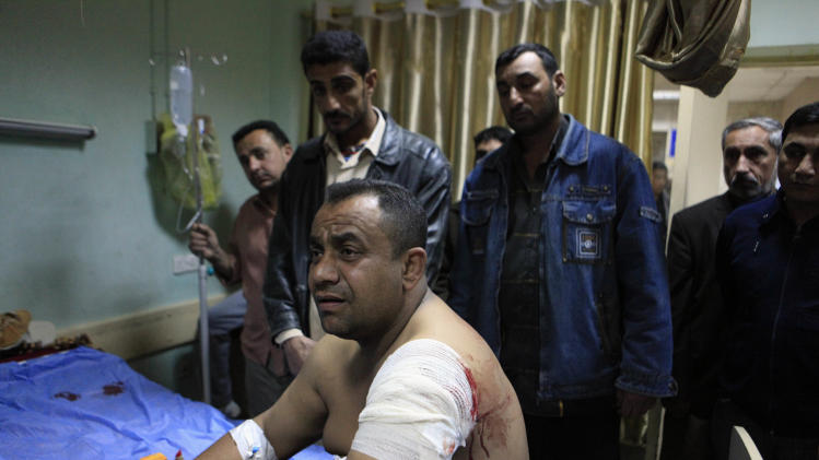 A man receives treatment at a hospital after being injured in a car bomb in the Shiite enclave of Sadr City, in Baghdad, Iraq, Sunday, Feb. 17, 2013. A series of car bombs exploded within minutes of each other as Iraqis were out shopping in and around Baghdad on Sunday, killing and wounding scores of people, police said. (AP Photo/ Karim Kadim)