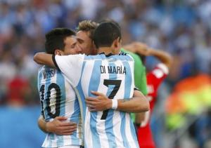 Argentina's Messi, Di Maria and Biglia celebrate after 2014 World Cup round of 16 game between Argentina and Switzerland at the Corinthians arena