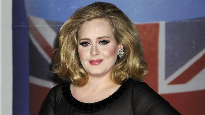 """FILE - In this Feb. 21, 2012 file photo, performer Adele arrives for the Brit Awards 2012 at the O2 Arena in London.  The 24-year-old British songstress' album """"21"""" has sold more than 10 million copies, according to Nielsen SoundScan. The album reached the milestone the week of Nov. 19, 2012, less than two years after its release.  (AP Photo/Jonathan Short, File)"""