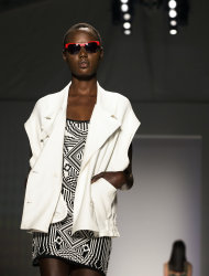 The Nicole Miller Spring 2013 collection is modeled during Fashion Week in New York, Friday, Sept. 7, 2012. (AP Photo/John Minchillo)