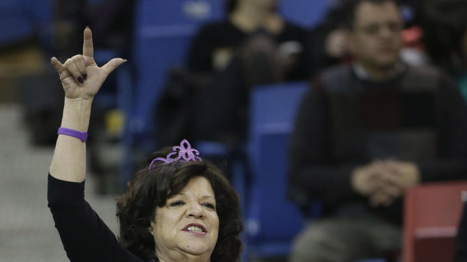 Sacramento Kings fan Gloria Bailey lets her feeling be known as the Kings played the Cleveland Cavaliers in an NBA basketball game in Sacramento, Calif., Monday, Jan. 14, 2013. The Kings won 124-118.  The Maloof family, owners of the Kings, are rumored to be in negotiations to sell the team to a group headed by investor Chris Hansen who would relocate the team to Seattle. (AP Photo/Rich Pedroncelli)