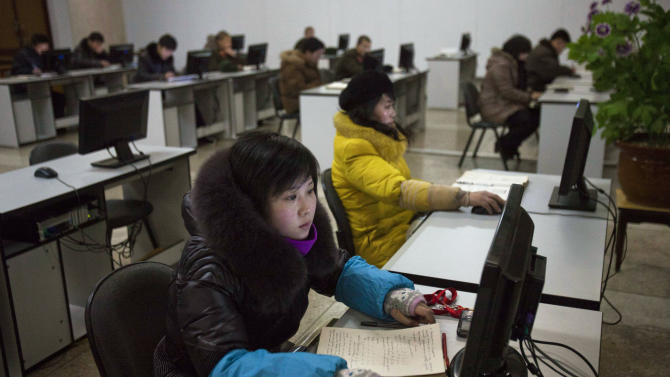 """FILE - In this Jan. 9, 2013 file photo, North Koreans work at computer terminals inside the Grand People's Study House in Pyongyang, North Korea. Investigators have yet to pinpoint the culprit behind a synchronized cyberattack in South Korea last week. But in Seoul, the focus remains fixed on North Korea, where South Korean security experts say Pyongyang has been training a team of computer-savvy """"cyber warriors"""" as cyberspace becomes fertile battlegrounds in the standoff between the two Koreas.  (AP Photo/David Guttenfelder, File)"""