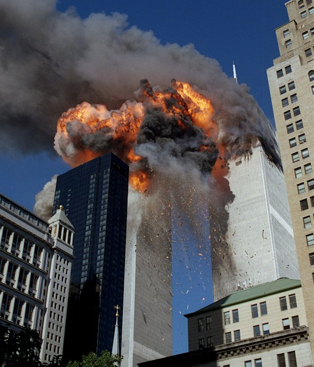 FILE - In this Sept. 11, 2001 file photo, smoke, flames and debris erupt from one of the World Trade Center towers after a plane strikes it, in New York. The first tower was already burning following