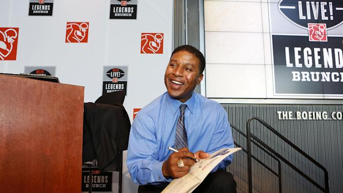 IMAGE DISTRIBUTED FOR NFLPA - CBS broadcaster Spencer Tillman smiles as he signs autographs following the NFLPA Legends Brunch at the National World War II Memorial Museum on Sunday, Feb. 3, 2013 in New Orleans, Louisiana. (Aaron M. Sprecher/AP Images for NFLPA)
