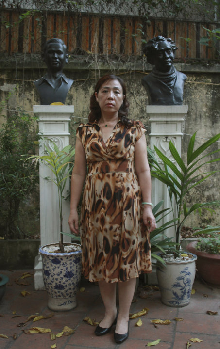 In this photo taken Monday, June 17, 2013, lawyer Nguyen Thi Duong Ha stands in the courtyard of her home in downtown Hanoi, Vietnam. Her husband Cu Huy Ha Vu is entering the fourth week of a prison h