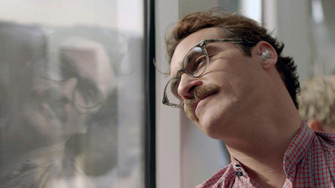 """This image released by Warner Bros. Pictures shows Joaquin Phoenix in a scene from the Spike Jonze film, """"Her."""" """"Her"""" has been selected as the best film of the year by the National Board of Review. (AP Photo/ Warner Bros. Pictures)"""