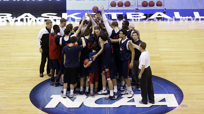 Gonzaga players including Kelly Olynyk huddle following practice for a second-round game of the NCAA college basketball tournament, Wednesday, March 20, 2013, in Salt Lake City. Gonzaga is scheduled to play Southern University Thursday.  (AP Photo/Rick Bowmer)