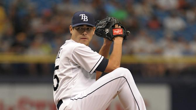 Tampa Bay Rays starter Matt Moore pitches against the Cleveland Indians during a baseball game Thursday, July 2, 2015, in St. Petersburg, Fla. The game is Moore's first MLB start since undergoing Tommy John surgery 14 months ago.(AP Photo/Steve Nesius)
