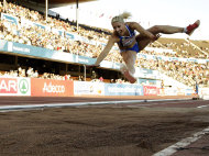 "FILE- Greece's Voula Papachristou soars through the air in the Women's Triple Jump final at the European Athletics Championships in Helsinki, Finland, in this file photo dated Friday, June 29, 2012. The Hellenic Olympic Committee has removed triple jumper Voula Papachristou from the team taking part in the upcoming London Olympic Games over comments she made on twitter making fun of African immigrants and expressing support for a far-right party. ""The track and field athlete Paraskevi (Voula) Papachristou is placed outside the Olympic Team for statements contrary to the values and ideas of the Olympic movement,"" a statement by the Hellenic Olympic Committee says. Papachristou is in Athens, and was to travel to London ""shortly before the track events start,"" the announcement says.(AP Photo/Matt Dunham, file)"
