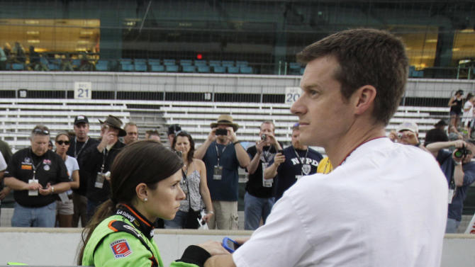 IndyCar driver Danica Patrick, left, and her husband Paul Hospenthal wait for her turn to qualify on the final day of qualifications for the Indianapolis 500 auto racing at the Indianapolis Motor Speedway in Indianapolis, Sunday, May 22, 2011. (AP Photo/Darron Cummings)