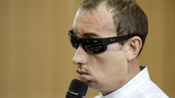 """Poland's first face transplant patient, identified only by his first name Grzegorz, speaks at a press conference after he was discharged from the hospital, in Gliwice, Poland, Tuesday, July 30, 2013. The 33-year-old man said he owes his doctor """"everything"""" following a skin-and-bone transplant on May 15, three weeks after losing his nose, upper jaw and cheeks in an accident at the brick factory where he worked. (AP Photo/Tomasz Griessgraber) POLAND OUT"""