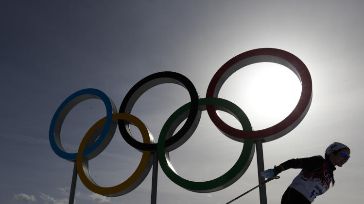 FILE - In this file photo dated Thursday, Feb. 20, 2014, a skier passes by the Olympic rings at the 2014 Winter Olympics, in Krasnaya Polyana, Russia. Overshadowed by the international crisis over Ukraine, Russia welcomes the sporting world back to Sochi this week for the Winter Paralympics that will be snubbed by some politicians and will struggle to match the successful Winter Olympics that ended less than two weeks ago in the Russian Black Sea resort. (AP Photo/Felipe Dana, FILE)