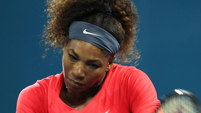 Serena Williams of the United States plays a shot in her match against Alize Cornet of France at the Brisbane International tennis tournament in Brisbane, Australia, Tuesday, Jan. 1, 2013.  (AP Photo/Tertius Pickard).