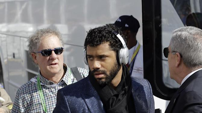 Seattle Seahawks quarterback Russell Wilson arrives before the NFL Super Bowl XLIX football game against the New England Patriots  Sunday, Feb. 1, 2015, in Glendale, Ariz. (AP Photo/Mark Humphrey)