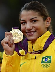 Brazil's gold medalist Sarah Menezes poses on the podium women's -48 kgs contest of the judo event at the London 2012 Olympic Games on July 28, 2012 in London.        AFP PHOTO / ADRIAN DENNIS