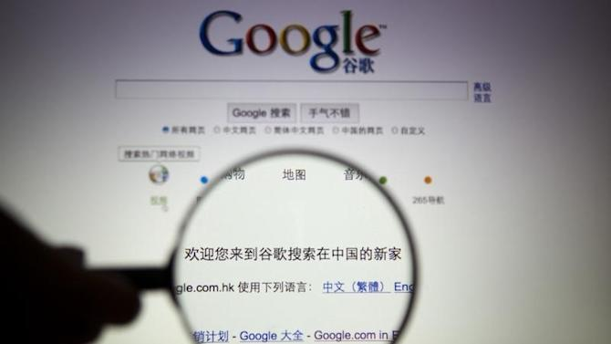 A person poses with a magnifying glass in front of a Google search page in this illustrative photograph taken in Shanghai