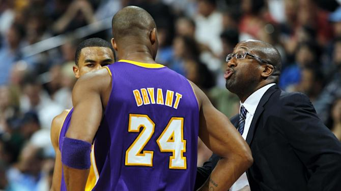 Los Angeles Lakers head coach Mike Brown, right, makes a point to his guards Ramon Sessions, back left, and Kobe Bryant during a time out against the Denver Nuggets early in the fourth quarter of the Nuggets' 113-96 victory in Game 6 of the teams'  first-round NBA basketball series in Denver on Thursday, May 10, 2012. (AP Photo/David Zalubowski)