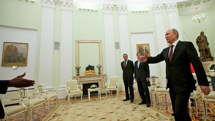 Russian President Vladimir Putin, right, walks to shake hands with United Nations special envoy Kofi Annan prior their talks in Moscow,  Russia, Tuesday, July 17, 2012. The UN and Arab League envoy to the Syrian crisis has begun his meeting with the Russian president by saying that Syria is at a crossroads, as violence escalates. (AP Photo/Alexander Zemlianichenko)