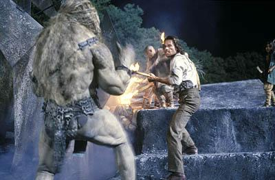 Guy Pearce as scientist and inventor Alexander Hartdegen fighting with a ferocious Morlock in Dreamworks' and Warner Brothers' The Time Machine