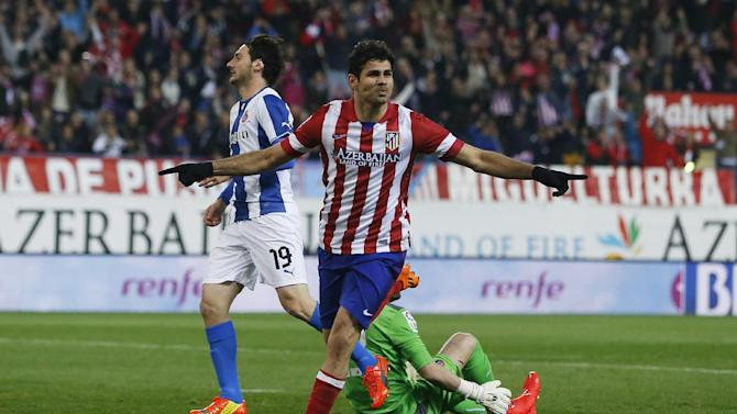 Atletico's Diego Costa, center, celebrates his goal during a Spanish La Liga soccer match between Atletico Madrid and Espanyol at the Vicente Calderon stadium in Madrid, Spain, Saturday, March 15, 2014