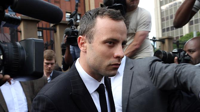 Oscar Pistorius leaves the high court in Pretoria, South Africa, Wednesday, April 9, 2014. Pistorius is charged with murder for shooting dead his girlfriend, Reeva Steenkamp, on Valentines Day in 2013. (AP Photo/Themba Hadebe)