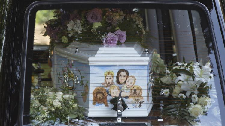 A hearse carrying the coffin of Peaches Geldof arrives for her funeral service at the Saint Mary Magdalene and Saint Lawrence church in Davington