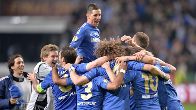 Chelsea players, with Fernando Torres, from Spain, in the center, celebrate at the end of the Europa League final soccer match between Benfica and Chelsea at ArenA stadium in Amsterdam, Netherlands, Wednesday May 15, 2013. Chelsea defeated Benfica 2-1. (AP Photo/Martin Meissner)