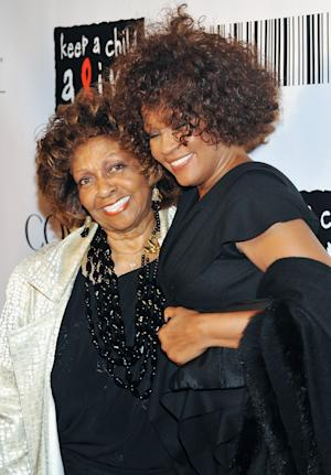 """FILE - In this Sept. 30, 2010 file photo, singers Cissy Houston, left, and her daughter Whitney Houston arrive at the """"Keep A Child Alive Black Ball"""" at the Hammerstein Ballroom in New York. Houston says in her first interview since daughter Whitney's death that she's """"very proud"""" of her and did the best she could raising her. Houston talked to My9 on Thursday night for an interview set to air Monday. The interview took place at New Hope Baptist Church in Newark, N.J., where Whitney first wowed a congregation as a girl and where her funeral was held Feb. 18. Houston says her daughter """"accomplished a whole lot in the short time that she had here"""" and """"was a very wonderful person."""" She says she doesn't blame herself for what happened to her because she knows she did the best she could. Whitney Houston, 48, died Feb. 11, in California. (AP Photo/Evan Agostini, file)"""