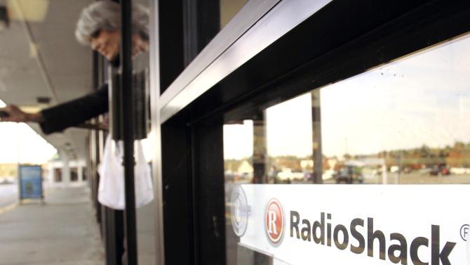 RadioShack 2Q loss widens, CFO leaves